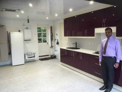 Garageflex managed the whole process from installing kitchen cabinets to laying a resin floor and adding wall storage.